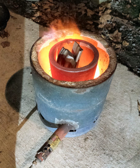 The DIY Propane furnace melting some scrap aluminium.
