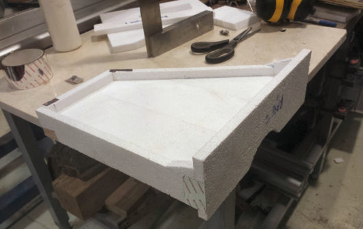 The foam pattern is cut mainly on the tablesaw, and glued and taped up on a flat surface, in this case an old marble floor tile.